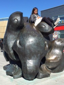 Girl on sculpture in Nuuk, Greenland