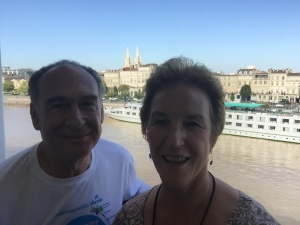 Selfie from our balcony with church and riverboats in background