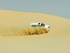 Sliding down a dune sideways